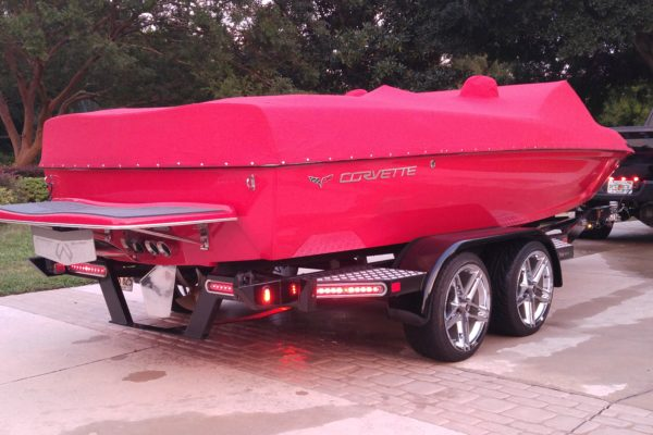 A red boat in a trailer