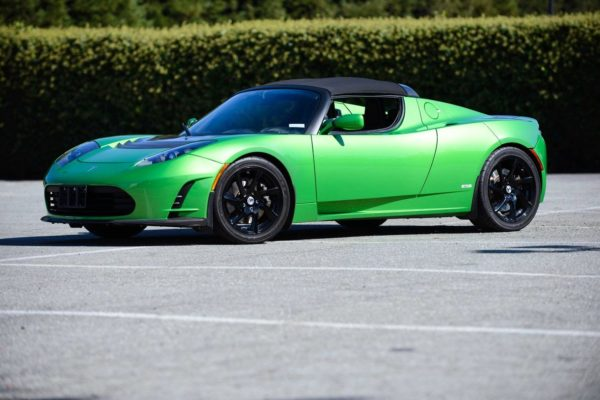 A green sports car parked