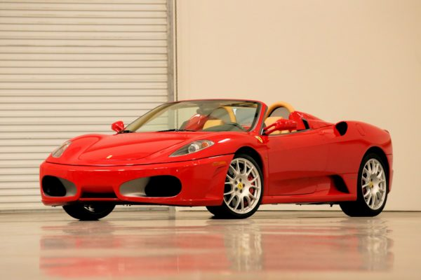 A red Ferrari parked in a storage facility