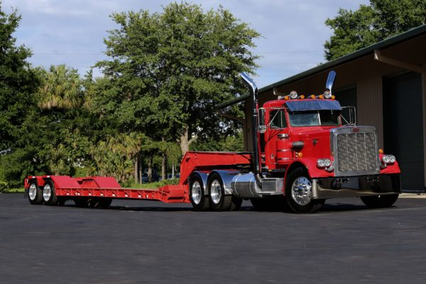 A red trailer truck