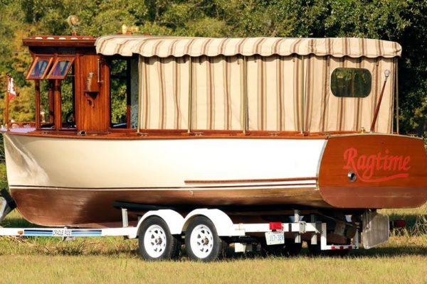 Orange boat on a boat trailer