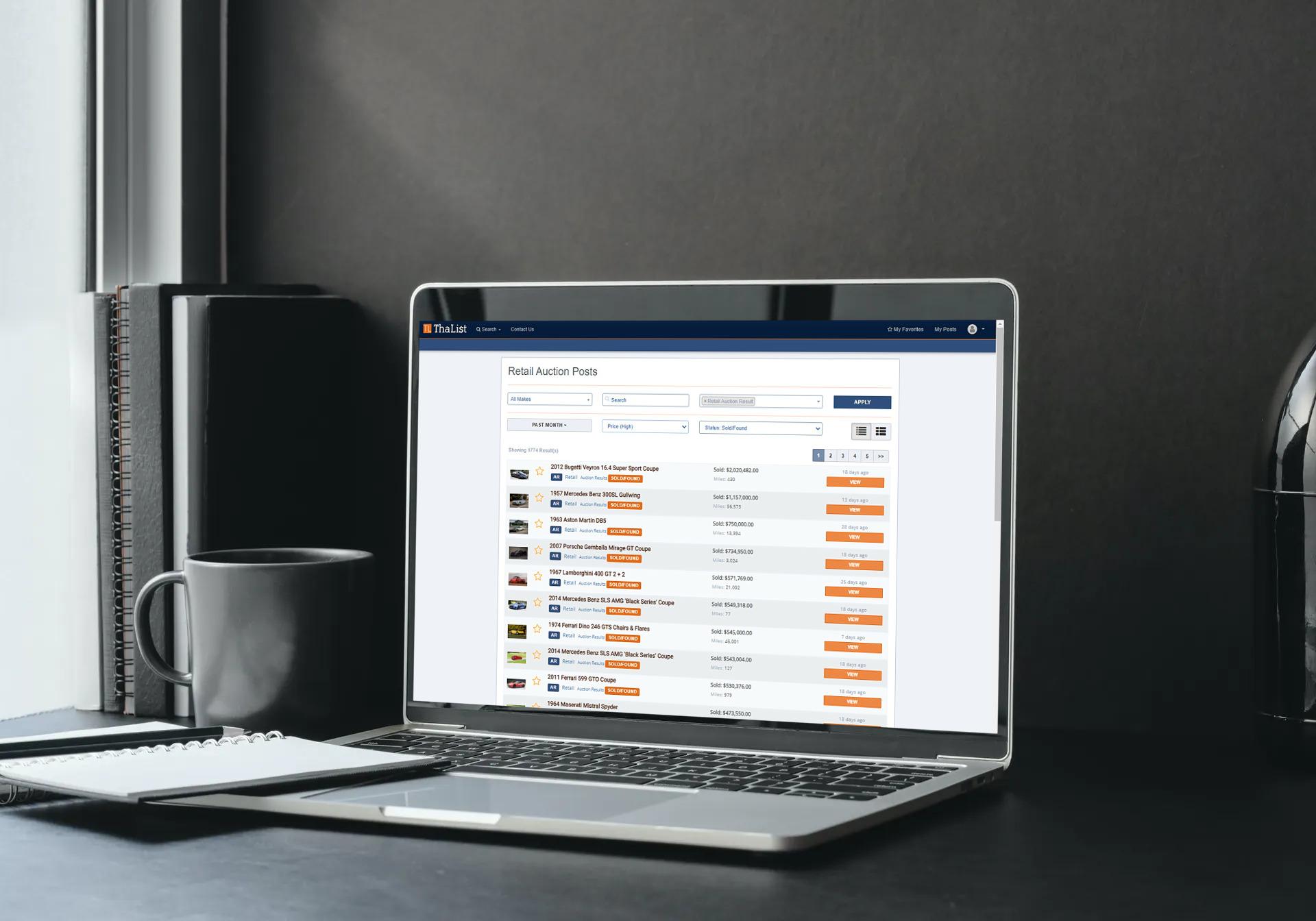 A laptop displaying car retail auction posts